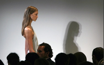 A model presents a creation from the Calvin Klein Spring 2008 collection during New York Fashion Week, September 11, 2007.