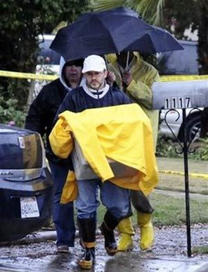 Investigators leave the scene were nine bodies were found in the ashes of a home, Thursday, Dec. 25, 2008 in Covina, Calif., where a gunman in a Santa Claus costume opened fire during a Christmas Eve party, before setting the house ablaze, police said AP