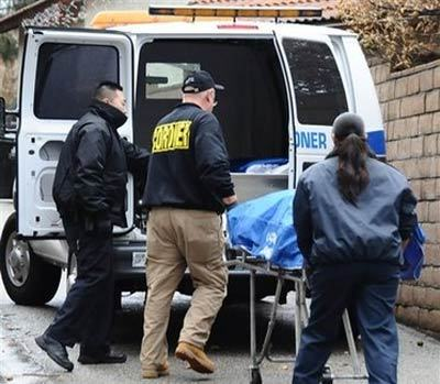 Los Angeles coroner officials remove the body of Bruce Pardo Thursday, Dec. 25, 2008, who is suspected of opening fire at a Christmas Eve party in a Covina, Calif. home that subsequently caught fire, leaving nine people dead. Authorities believe the 45-year-old Pardo died of a self-inflicted gunshot wound. Nine bodies were found at the home where the Christmas party took place, some 25 miles from where Pardo's body was found AP