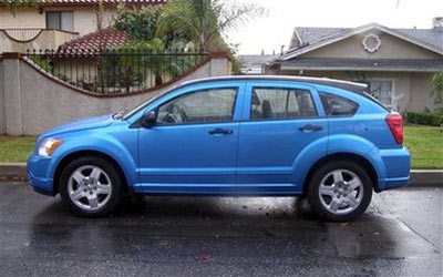 Dodge Caliber automobile on, Thursday, Dec. 25, 2008 in the Sylmar area of Los Angeles that Bruce Pardo drove to his brother's house before committing suicide. Pardo a man who carried out a Christmas AP