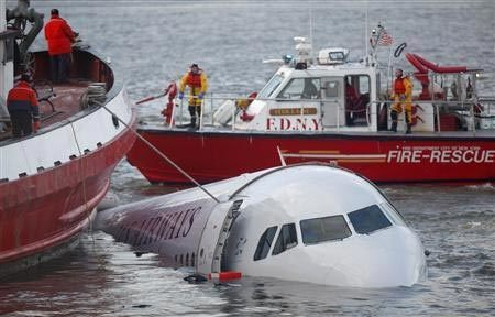 Rescue vessels surround a U.S. Airways plane after it crashed into the Hudson River in New York January 15, 2009.
