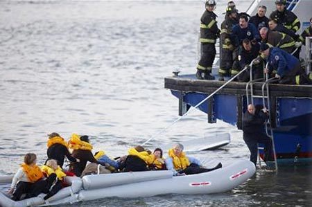 Passengers are rescued after a U.S. Airways plane landed in the Hudson River in New York January 15, 2009.