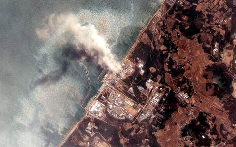 14 March 2011: A fire is seen burning at the Fukushima Dai-ichi Nuclear Power plant in this satellite image