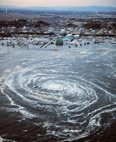A whirlpool forms in the sea near a port in Oarai, Ibaraki Prefecture
