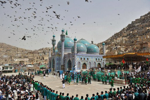 Afghans gather for a new year ceremony at the Sakhi Shrine in Kabul on March 20, 2012, during celebrations marking the start of Noruz, the Afghan new year. Noruz, one of the biggest festivals of the war-scarred nation, marks the spring equinox marks the solar year of 1390.