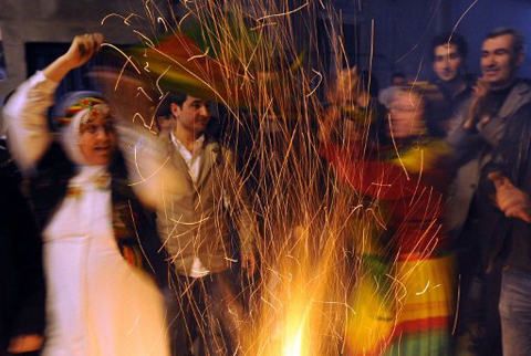 A fire burns as Kurds celebrate Noruz in Beyoglu, Istanbul, on March 21, 2012. The festival began on March 20 and traditionally know as the Iranian New Year, is celebrated in Turkey, central Asian republics, Iraq, Azerbaijan as well as war-torn Afghanistan, and coincides with the astronomical vernal equinox.