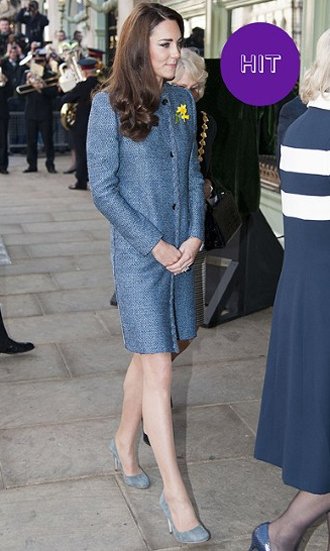 For a trip to Fortnum & Masons with the Queen and Duchess of Cornwall, Kate chose a petrol blue tweed coat by Italian label MIssoni: departure from her favourite home-grown brands, but when she looks this pretty, what does it matter?