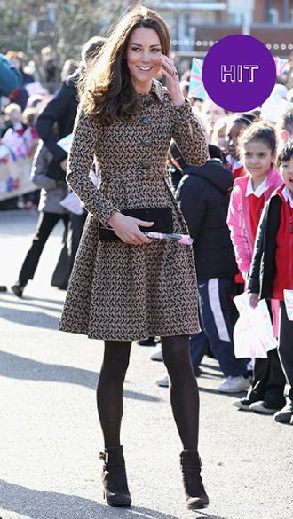 The Duchess chose a dress by London Fashion Week designer Orla Kiely for this public appearance in Oxford. Trading in her usual knee-high boots or grown-up court shoes and the high almost-empire line waist gave the look a youthful edge.