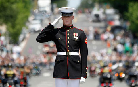 A Marine salutes as motorcycles drive past during the annual Rolling Thunder parade ahead of Memorial Day in Washington, Sunday, May 27, 2012.AP