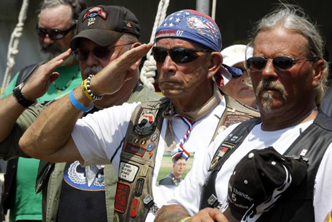 Members of Rolling Thunder salute during the presentation of colors during the annual Rolling Thunder rally on the National Mall ahead of Memorial Day in Washington, Sunday, May 27, 2012. AP