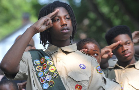 Stevon Spears, 17 and members of Boy Scout Troop 445 salute the American flag during the Memorial Day observance ceremony at the Memphis National Cemetery in Memphis, Tenn. Saturday, May 26, 2012. For 29 years members of the Boy Scouts, Girl Scouts and American Heritage Girls have placed flags on the 42,000 graves at the Memphis National Cemetery during a ceremony honoring veterans for the Memorial Day Celebration.AP