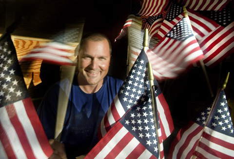 "Air Force veteran and Anaheim police officer Brennan Leininger was ""saddened"" last Memorial Day when he realized more than half the 150,000 graves at Riverside National Cemetery did not have flags. He raised more than $15,000 and was able to purchase 21,600 flags that he and about 300 Orange County volunteers will place on graves Saturday May 26, 2012. Next year he hopes to be able to raise enough money to adorn all 150,000. ""A lot of people just think it gets done,"" he said.AP"
