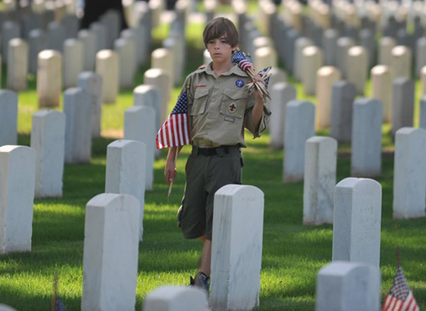 Matthew Russell, 11, from Memphis prepares to place American flags at the headstones of veterans during the Memorial Day observance ceremony at the Memphis National Cemetery in Memphis, Tenn. Saturday, May 26, 2012. For 29 years members of the Boy Scouts, Girl Scouts and American Heritage Girls have placed flags on the 42,000 graves at the Memphis National Cemetery during a ceremony honoring veterans for the Memorial Day CelebrationAP
