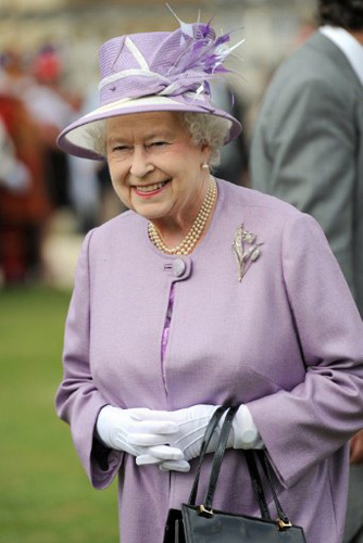 : Britain's Queen Elizabeth II attends a garden party at Buckingham Palace, in London, on May 29, 2012