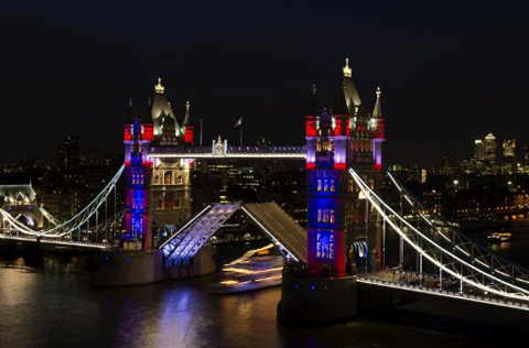 A new eco-friendly lighting system on Tower Bridge illuminates the structure with colors, on May 30, 2012. The new lighting on Tower Bridge was switched on today after a six-month renovation, ahead of the Queen's Diamond Jubilee and the London 2012 Olympics.