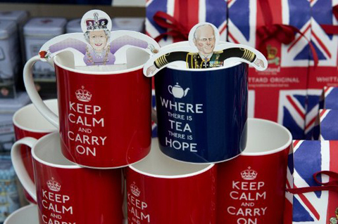 Royal memorabilia featuring Britain's Queen Elizabeth II and Prince Philip are displayed for sale at a shop in central London, on June 1, 2012. The diamond jubilee public holiday long weekend running from Saturday June 2, 2012 to Tuesday June 5, 2012, will see Britons participate in events across the country to celebrate Queen Elizabeth II's 60 years on the throne.