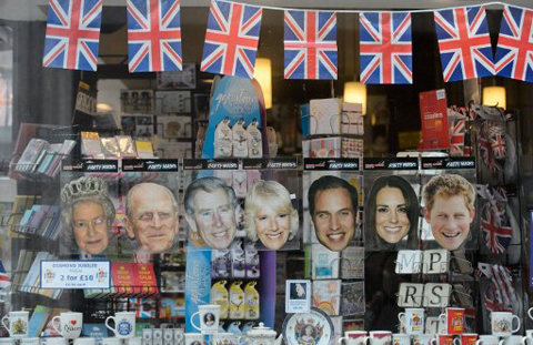 Souvenirs including paper masks of (L-R) Britain's Queen Elizabeth II, Prince Philip, Duke of Edinburgh, Prince Charles, Prince of Wales, Camilla, Duchess of Cornwall, Prince William, Catherine, Duchess of Cambridge and Prince Harry are displayed at a store in central London on May 31, 2012 ahead of the long weekend of celebrations to mark the Queen's diamond jubilee.