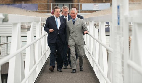 Prince Charles, Prince of Wales (R), boards the ship the 'Edwardian' with Pageant Master Adrian Evans (C) and Chairman of the Thames Diamond Jubilee Foundation Lord Salisbury (L) on the river Thames in London on May 31, 2012 as he views preparations for the Thames Jubilee River Pageant. Prince Charles, as patron of the Thames Jubilee Pageant, visited the Avenue of Sail to view preparations for the 1000-boat spectacle that will be part of events to commemorate his mother the Queen's 60-year reign