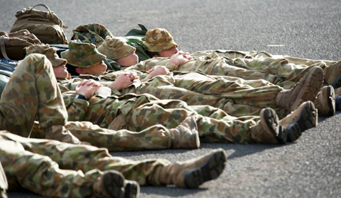 Members of the Australian Army sleep alongside the amphibious assault ship USS Essex (LHD 2) before training evolutions with Kingdom of Tonga, Indonesian, and U.S. Marines and Canadian soldiers.