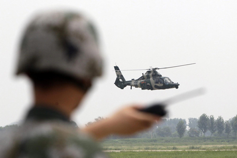 A Z-9WZ military helicopter designed and manufactured by China performs during a media visit at the military base of Chinese People's Liberation Army Army Aviation 4th Helicopter Regiment, on the outskirts of Beijing, July 24, 2012, ahead of Army Day on August 1. [Photo/Agencies]