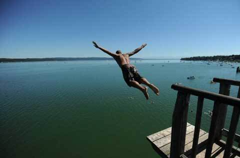 A man jumps into lake Ammersee in Utting, southern Germany, on August 18, 2012. Temperatures are on a record high throughout Germany this weekend of August 18-19, 2012.