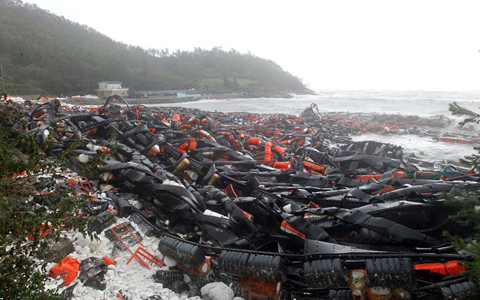A beach covered with equipment used for abalone farming is seen in the aftermath of Typhoon Bolaven in Wando, about 360 kms south of Seoul