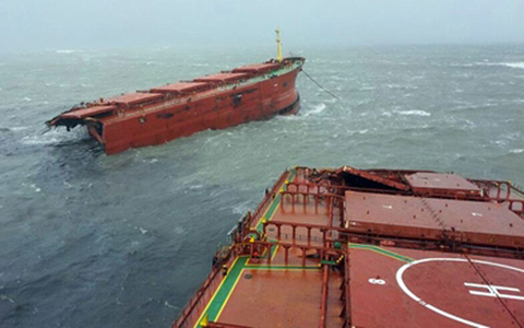 A 77,000-tonne bulk carrier which broke in two is seen off the port of Sacheon, about 300 kms southeast of Seoul