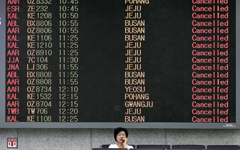 An arrivals signboard at Gimpo Airport in Seoul shows all flights from domestic origins have been cancelled