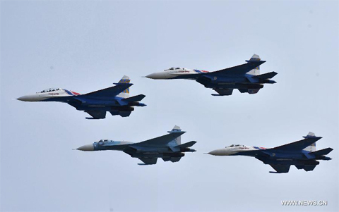 "Four Su-27 fighter jets of Russian aerobatic tam ""Russian Knights"" perform a test flight in Zhuhai, south China's Guangdong Province, Nov. 12, 2012. The 9th China International Aviation and Aerospace Exhibition will kick off on Tuesday in Zhuhai. (Xinhua/Liang Xu)"