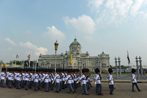 Royal Guards parade ahead of an address by Thai King Bhumibol Adulyadej at the Anantasamakom Throne Hall (background) in Royal Plaza in Bangkok's historic district on December 5, 2012.