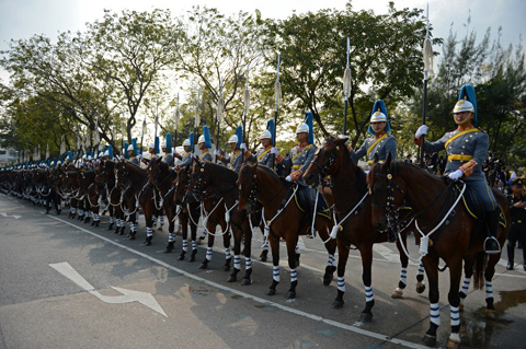 Horse-mounted Royal Guards line up ahead of an address by Thai King Bhumibol Adulyadej at the Anantasamakom Throne Hall in Royal Plaza in Bangkok's historic district on December 5, 2012