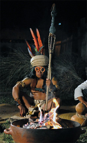 An indigenous man representing a Maya king sits at the Centroamerica square, near the Copan archaeological park