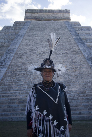 A Mexican man in costume is seen at Chichen Itza archaeological park, in Yucatan state, Mexico on December 20, 2012