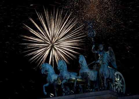 Fireworks erupt over the Brandenburg Gate on January 1, 2013 in Berlin as part of the New Year's celebrations.