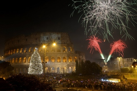 Fireworks light up the ancient Colisseum in central Rome's via dei Fori just after midnight on January 1, 2013. World cities from Sydney to Dubai rang in the New Year with a spectacular global wave of firework displays. ...