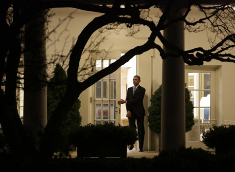US President Barack Obama departs the White House after delivering a statement late January 1, 2013 in Washington DC. Obama, who is heading to Hawaii to resume his annual vacation, said he had fulfilled a campaign promise to make the US tax system fairer with a deal to avert the fiscal cliff crisis that passed after a fierce duel in Congress.