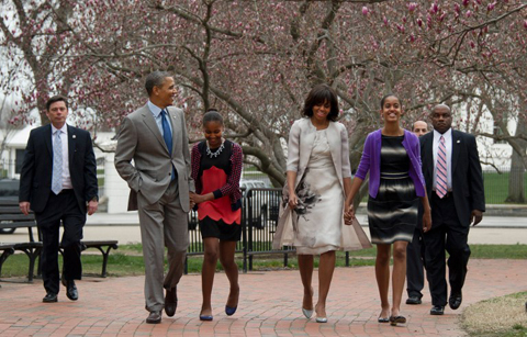 S President Barack Obama and First Lady Michelle Obama walk through Lafayette Park with daughters Sasha(3rd-L) and Malia to St. John's Episcopal Church for Easter Service March 31, 2013 in Washington, DC.