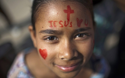 A girl attends a religious gathering to mark Easter Sunday in Kathmandu, Nepal