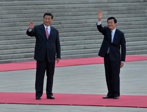 Chủ tịch Trung Quốc Tập Cận Bình và Chủ tịch nước Trương Tấn Sang. Ảnh: AFP