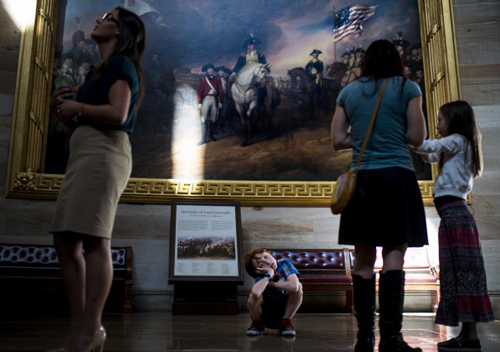 Ian McKendrick, 8, of Vancouver, Wash., shows a little boredom as tours go on in the Capitol Rotunda.