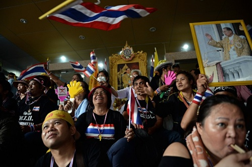 Bhumibol Adulyadej, as they sit inside the compound of the Finance Ministry after they stormed it in Bangkok on November 25, 2013