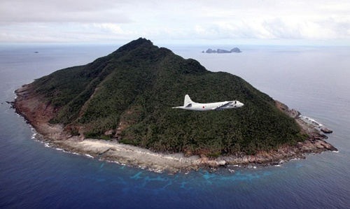 P-3C patrol plane of Japanese Maritime Self-Defense Force flying over the disputed islets, known as the Senkaku islands in Japan and Diaoyu islands in China, in the East China Sea.