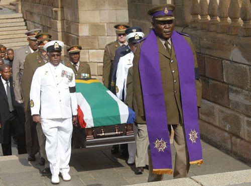 Soldiers in formal uniforms carried Mandela's casket into the Union Buildings to a special viewing center built inside the building's amphitheater, which President Jacob Zuma named after Mandela by decree Tuesday.  Mandela's body will lie in state for three days.