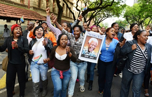 Some residents of Pretoria lined the streets to watch the procession go by. They sang old struggle songs and called out their farewells to Mandela, who died Dec. 5 at the age of 95.