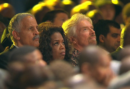 [Caption]A screengrab taken from the South African Broadcasting Corporation live feed shows US talk show host Oprah Winfrey, her husband Stedman Graham (L) and English businessman Richard Branson (R) watching the funeral service of late South African President Nelson Mandela in his childhood village of Qunu on December 15, 2013. Mandela will be buried near the homestead, ending 10 days of national mourning and global tributes for the prisoner-turned-president who transformed his country and inspired the world.
