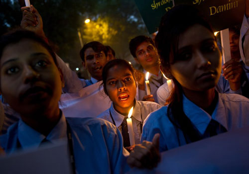 [Caption]Indian students take part in a candle-light vigil commemorating the December 2012 fatal gang-rape of an Indian woman, in New Delhi on December 16, 2013. The fatal gang-rape of a student on a bus in New Delhi shattered India's silence over sexual violence and emboldened victims to speak out, family members and campaigners said on the first anniversary of the attack