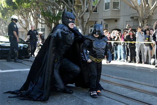 [Caption]Miles Scott, dressed as 'Batkid,' right, walked with an adult Batman impersonator in San Francisco on Nov. 15. The Make-A-Wish Foundation, thousands of residents and the White House joined an elaborate effort to help the 5-year-old leukemia patient play crime-fighter for a day.Batkid' Fights Crime in San FranciscoJeff Chiu/Associated Press