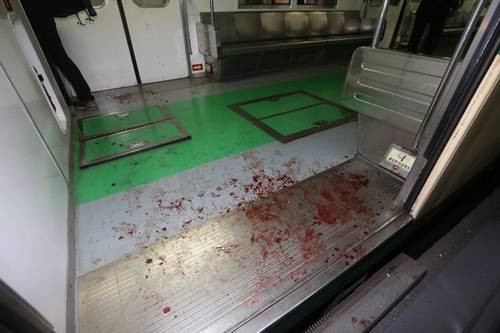 Blood marks are seen on the floor of a damaged subway train at a subway station in Seoul