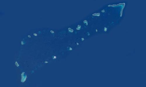 Hình ảnh chụp cụm Sinh Tồn tại quân đảo Trường Sa của Việt Nam từ trên không do NASA chụp lại, trong đó bãi Gạc Ma nằm ở điểm cuối phía nam.