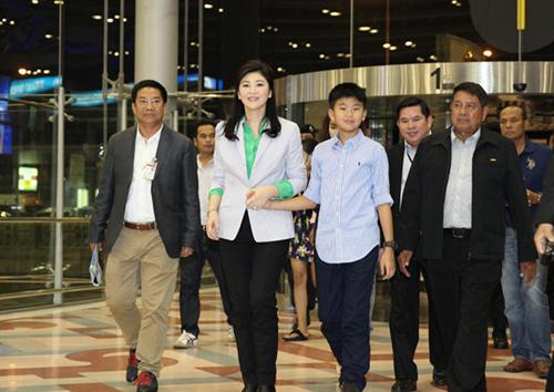 Yingluck về nước sau kỳ nghỉ, dập tắt tin đồn lưu vong